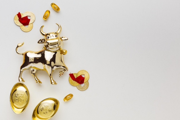traditional-new-year-chinese-ox-golden-objects_23-2148754776